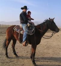 Austin Snedden getting help from his ranch hand